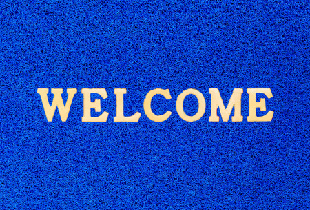 bule doormat and welcome text for background photo
