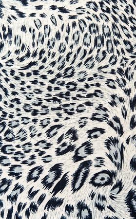 背景の縞模様のヒョウのファブリック