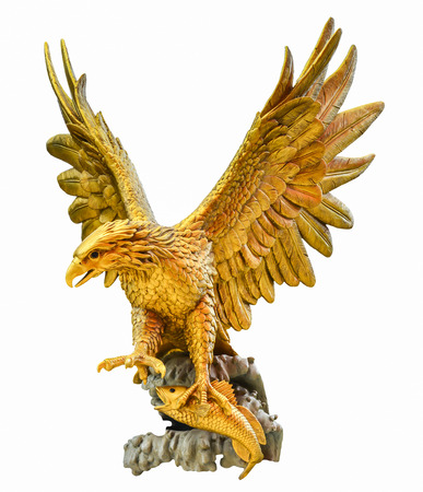golden eagle statue isolated on black background photo