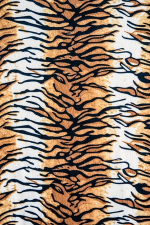Texture of tiger striped fabric for background