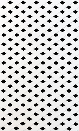 The texture of white slat wall isolated on black background photo