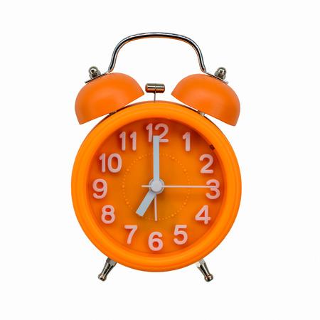 Orange alarm clock isolated on white background photo
