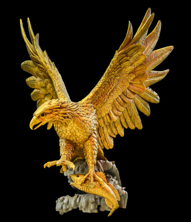 golden  gleam: golden eagle statue isolated on black background