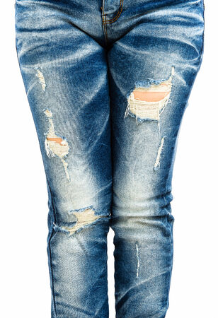 leg of women in fragmentary and torn jeans on white background photo