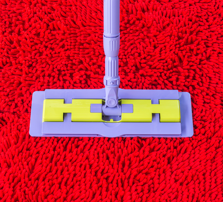 Vacuum cleaner for cleaning on red carpet photo