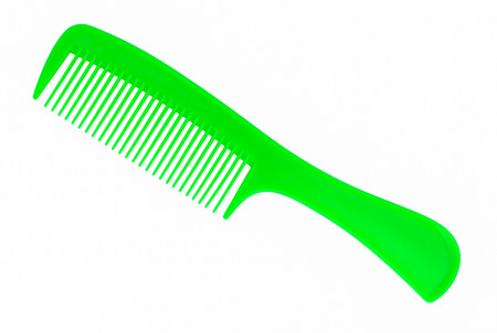 green hair comb isolated on white background