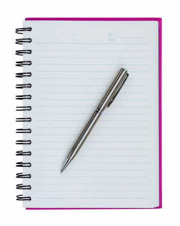 notebook: Silver ball point pen on pink notebook isolated on white background Stock Photo
