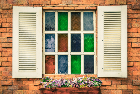 white window: vintage white window on red brick wall and flower in wooden vase