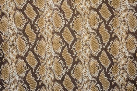 背景の印刷物の生地ストライプ ヘビ革の質感