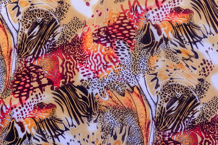 orange snake: texture of print fabric striped leopard for background