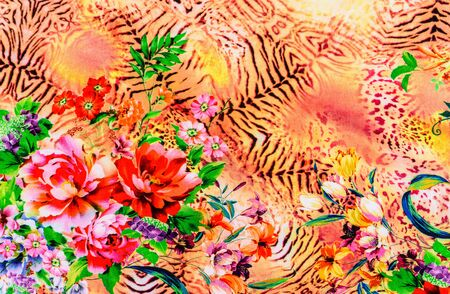 black leopard: texture of print fabric striped leopard and flower for background Stock Photo