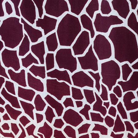 giraffe skin: texture of print fabric striped giraffe for background Stock Photo