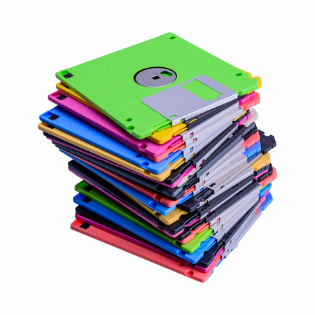 disks: stack of colorful floppy disks isolated on white background