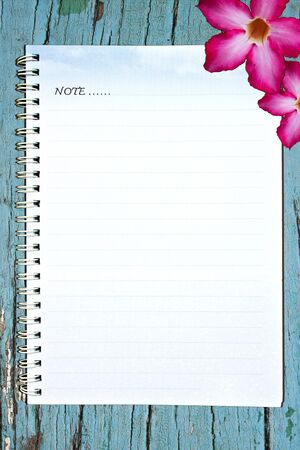 Notebook sheet with blue wood design photo