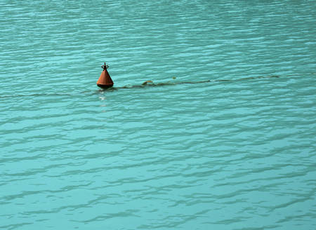 seaway: Bouy floating in the blue water. Stock Photo