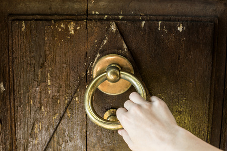 knocking: Hand is knocking the old door, knocker.