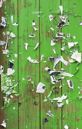 scraped: Old pieces of paper on a green billboard. Stock Photo