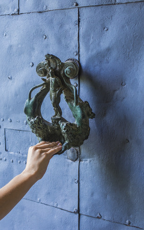 knocking: knocking on an old door handle