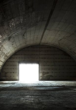 no way out: Old military hangar used to storage stuff. Stock Photo