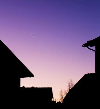 neighbourhood: Neighbourhood in a morning twilight with small moon. Stock Photo