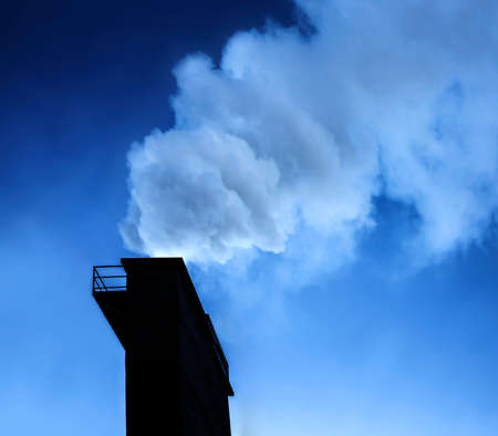 atmosphere: Dramatic industry chimney silhouette exausting co2 in the atmosphere.