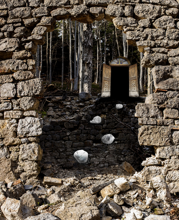 man made object: Demolished rock wall with an open opportunity door.