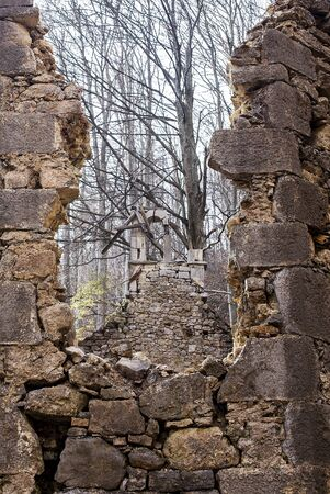 man made structure: Demolished old christian church in a forest.