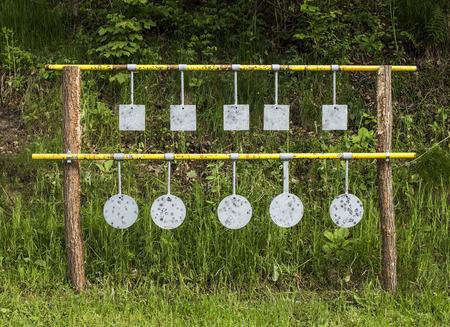 marksmanship: Ten metal targets, for practicing marksmanship.