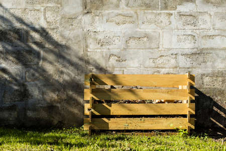 degrading: Compost box make with wood material.