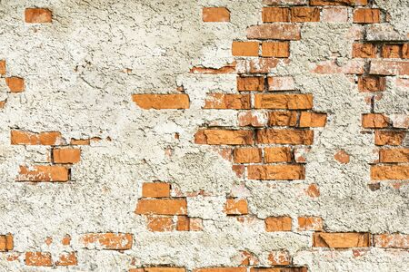 falling apart: Old brick wall is falling apart. Stock Photo
