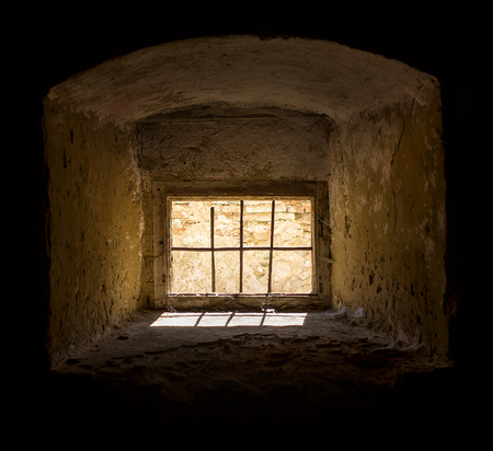 scarry: Old window with a metal bar with natural light.