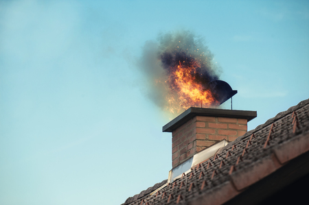 Chimney with fire coming out Stock Photo