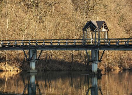 man made object: Wooden bridge over a river. Stock Photo