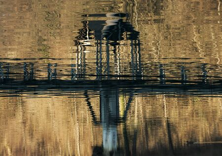 man made object: Wooden bridge reflection on a water. Stock Photo