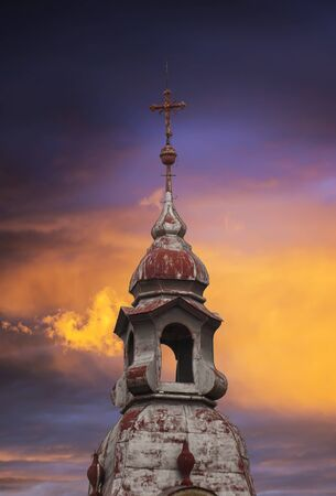 Catholic Church with a metal red top roof