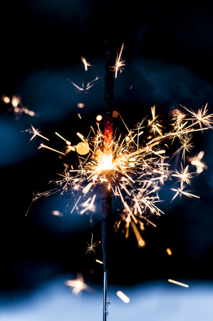 Sparkling fire stick with particles.