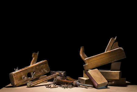 claw hammer: Wooden carpenter tools background isolated on black