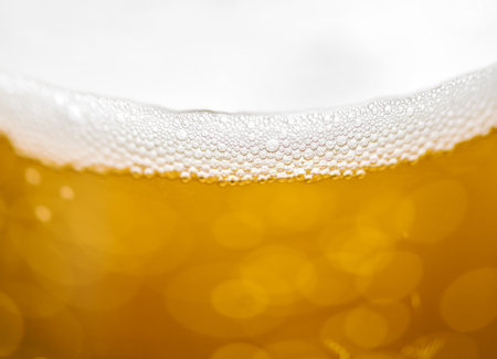 Blured beer background with bubbles.