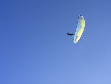 Enjoying time in the air with a parachute and Stok Fotoğraf