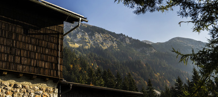 Part of Valvasor mountain cabin with a beautiful view in the morning time.