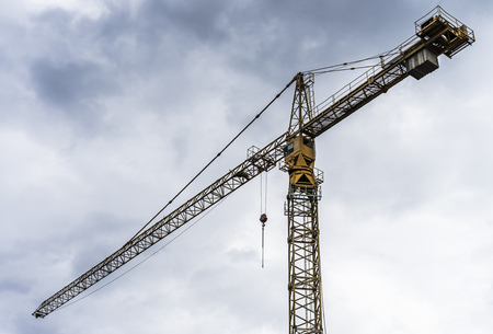 Construction crane is ready for lifting heavy objects.