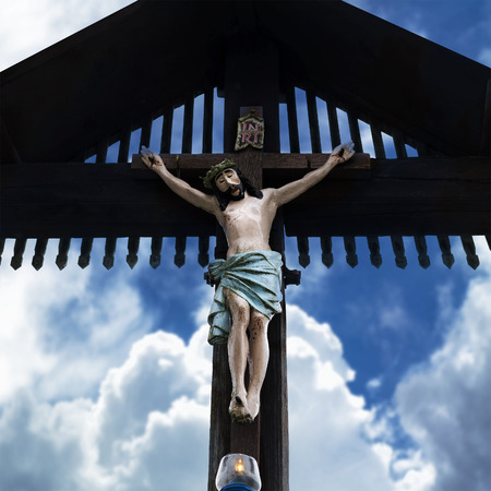 Jesus crucified on the wooden cross.