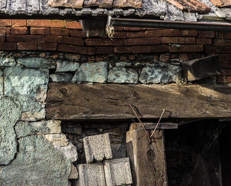 Very old building wall close up with many different building materials Stok Fotoğraf