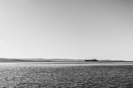 Ship is delivering cargo on a clear day. Stok Fotoğraf - 120368473