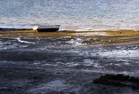 Small boat is lost on a shore with nothing around. Stok Fotoğraf - 120368481