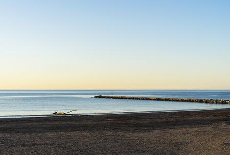 Small concrete dock over the mediterranean sea