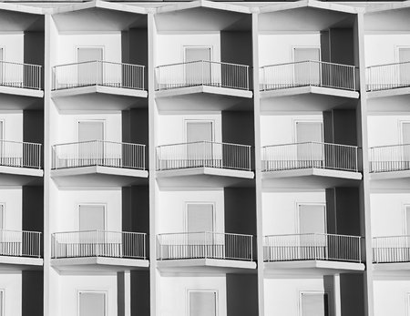 Small hotel rooms with identical balconies. Stok Fotoğraf - 120368548