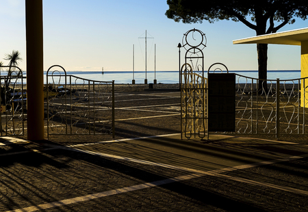 Small metal gates infront of the beach. Stok Fotoğraf - 120368550