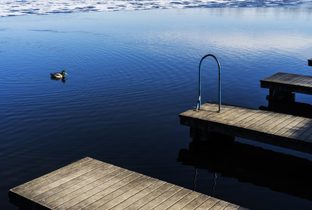 Small wooden docks above cold water in winter. Stok Fotoğraf - 120368564
