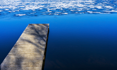 Small wooden docks above cold water in winter.